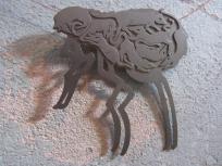 Ginger Bottari, Flea brooch (from the Black Plague series), saw pierced titanium
