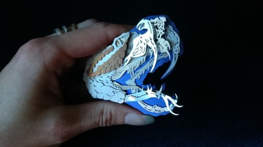 Ginger Bottari, Rattlesnake brooch from the Skullduggery series, saw pierced silver and titanium (anodised), sapphire