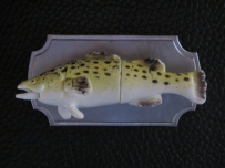 Ginger Bottari, Trophy Fish brooch, saw pierced titanium, collected object