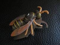 Ginger Bottari, Waspish brooch, saw pierced titanium, collected object