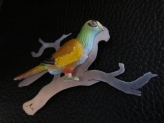 Ginger Bottari, Parrot brooch #1, saw pierced titanium, collected object