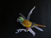 Ginger Bottari Parrot brooch #2, saw pierced titanium, collected object
