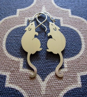 Ginger Bottari, Rattus earrings, saw pierced silver
