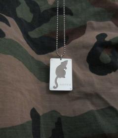 Ginger Bottari, Rat tag, saw pierced silver and titanium