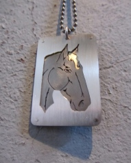 Ginger Bottari, Year of the Horse tag, saw pierced silver, brass and titanium