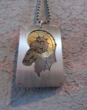 Ginger Bottari, Zodiac tags, Year of the Sheep, saw pierced silver brass and titanium