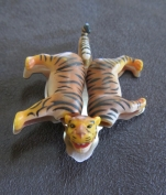 Ginger Bottari, Tigger brooch, saw pierced titanium, collected object