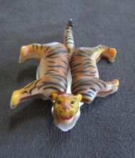 Ginger Bottari, Tigger brooch, saw pierced titanium, collected object