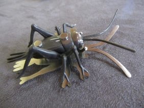 Ginger Bottari, Jimminy brooch, saw pierced titanium, collected object