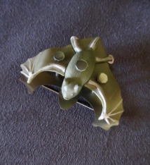 Ginger Bottari, Batty brooch, saw pierced titanium, collected object
