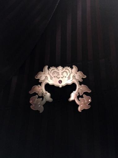 Ginger Bottari, Royal Garland brooch,  saw pierced silver and titanium, gemstone